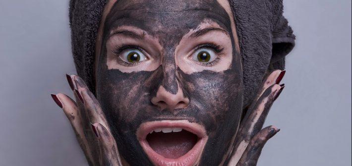 Woman with black face mask | exfoliating tips