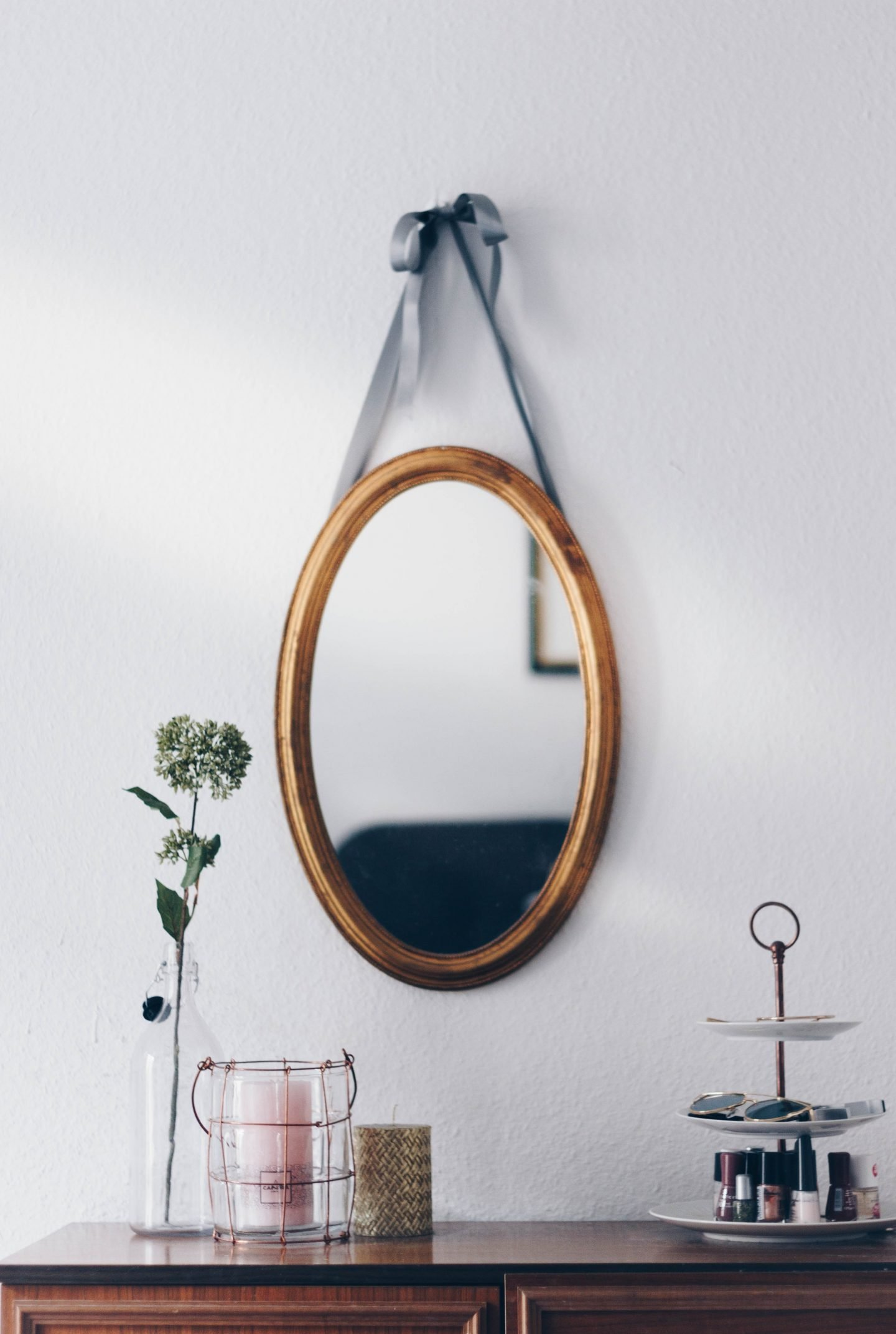 Makeup table and a round hanging mirror