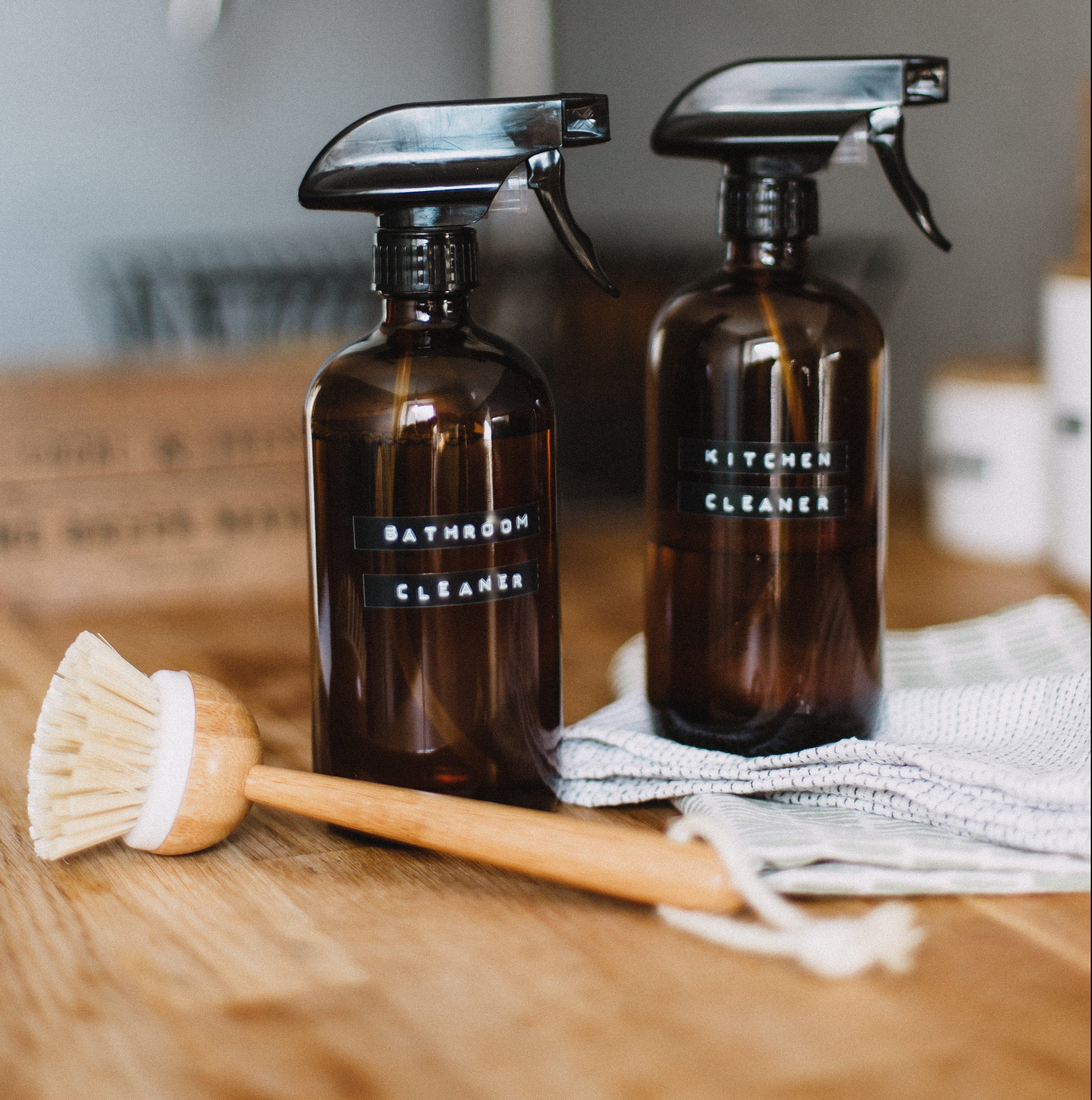 Bathroom and kitchen cleaner in brown spray bottles, buy at the dollar store