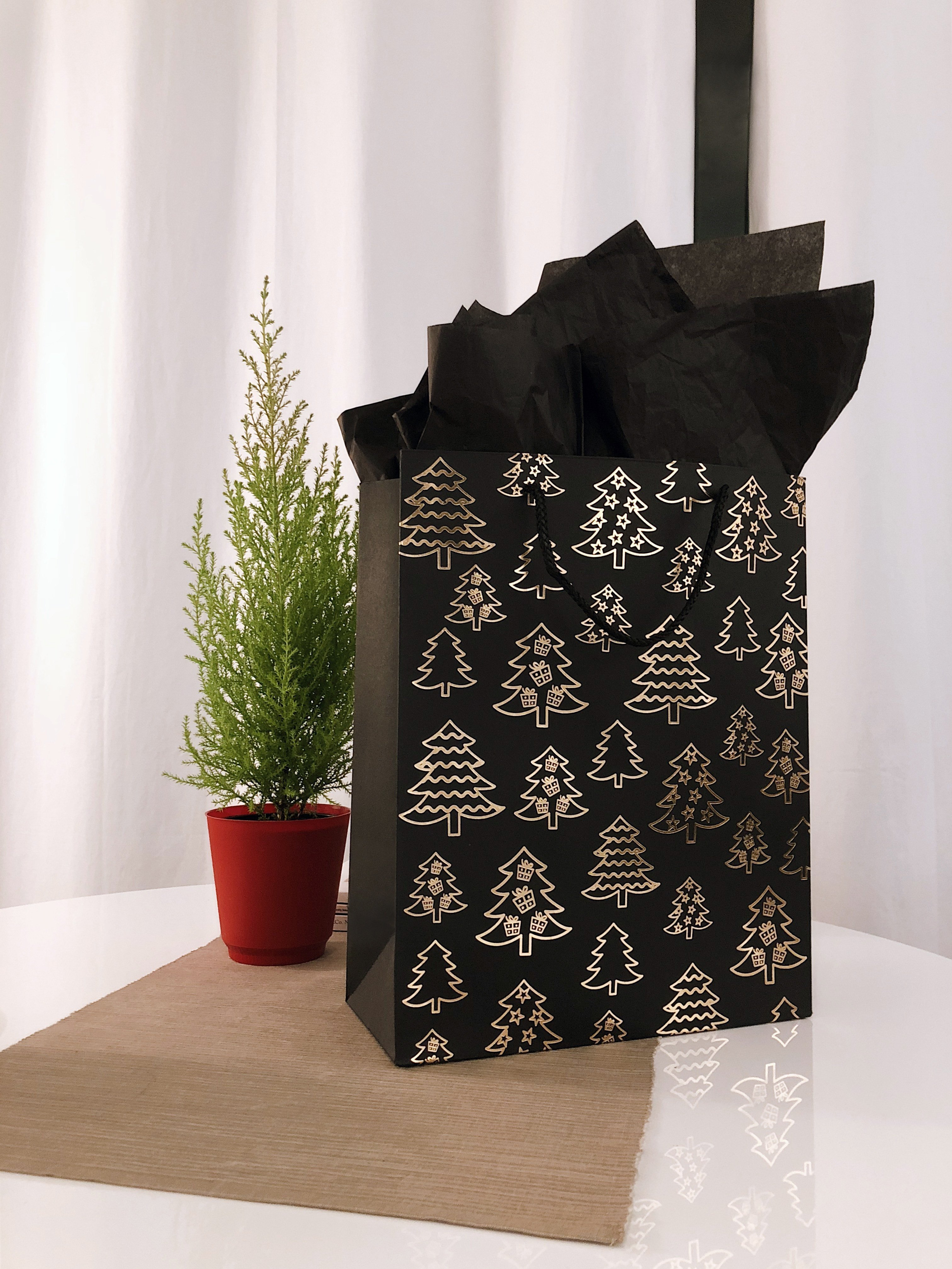 Black and gold gift bag with black wrapping paper