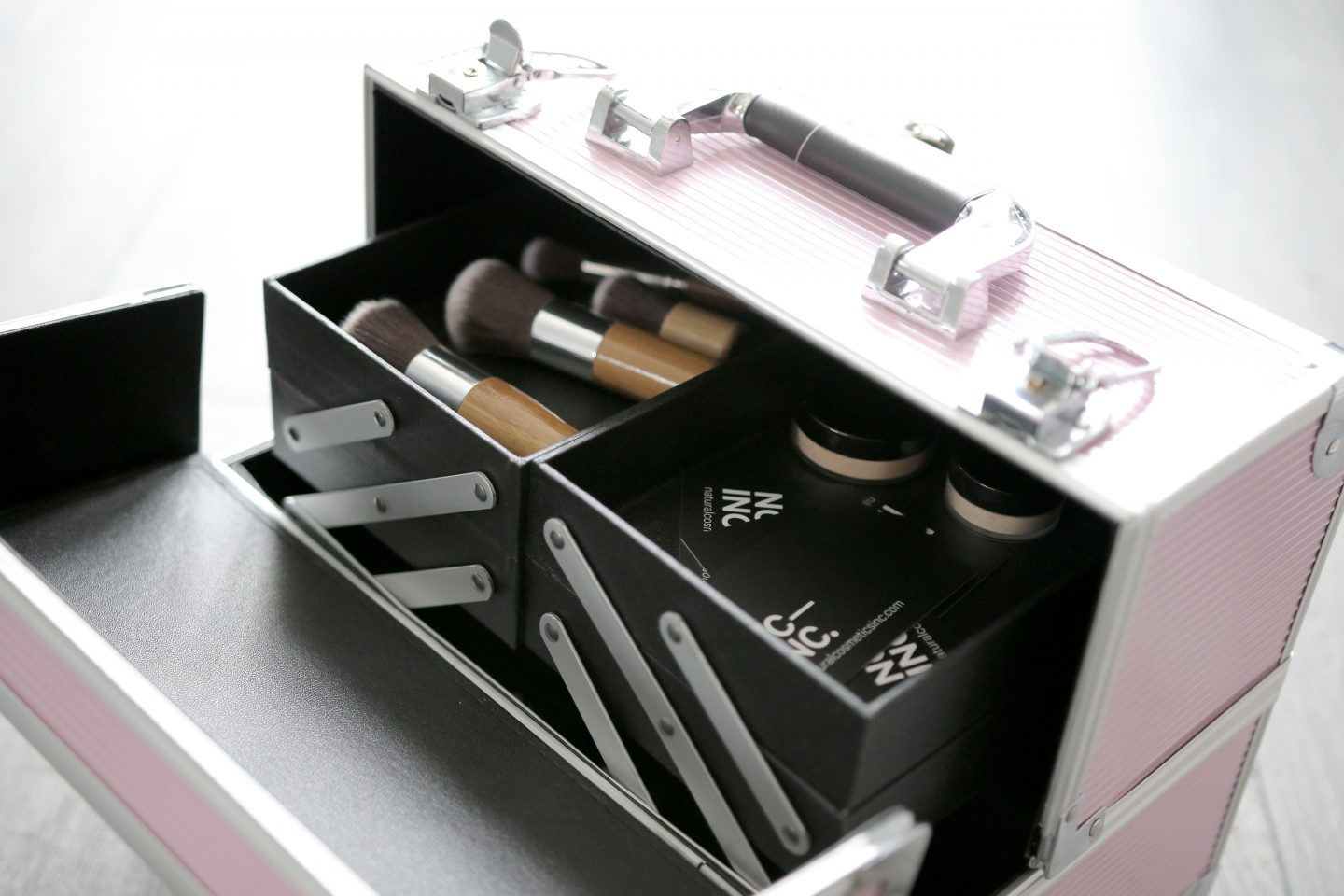 Professional makeup organization kit with makeup brushes and foundation