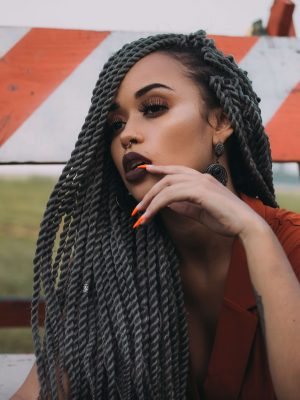 Beautiful woman with long braids and flawless makeup